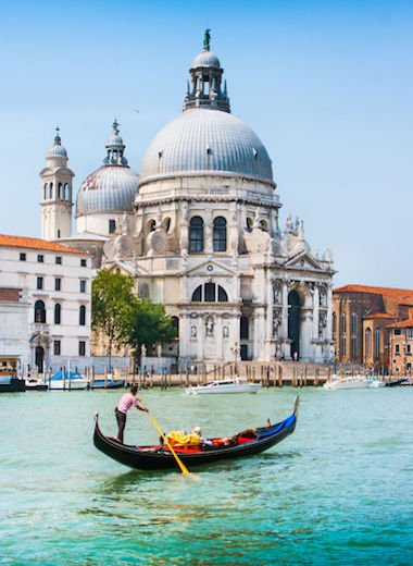 Traditional Gondola on Canal Grande with Basilica di Santa Maria della Salute in the background, Venice, Italy. Photo Credit: © Jakobrad L Gruber via 123RF.com
